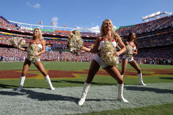 LANDOVER, MD - SEPTEMBER 11:  Washington Redskins cheerleaders peform as the Redskins take on the New York Giants at FedExField on September 11, 2011 in Landover, Maryland.  (Photo by Ronald Martinez/Getty Images)