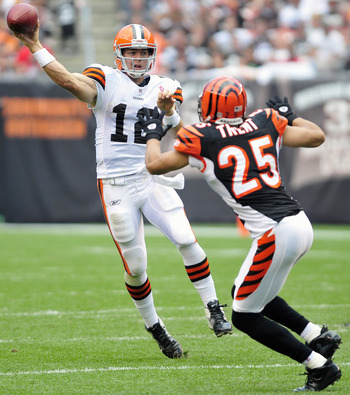 CLEVELAND, OH - SEPTEMBER 11: Starting quarterback Colt McCoy #12 of the Cleveland Browns makes a pass down field under pressure from corner back Morgan Trent #25 of the Cincinnati Bengals Cleveland  during the third quarter at Browns Stadium season opene