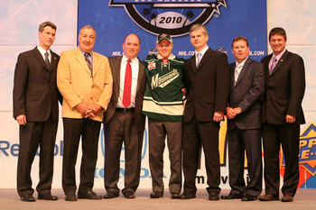 LOS ANGELES, CA - JUNE 25:  Mikael Granlund, drafted eighth overall by the Minnesota Wild, poses on stage with team personnel during the 2010 NHL Entry Draft at Staples Center on June 25, 2010 in Los Angeles, California.  (Photo by Bruce Bennett/Getty Ima
