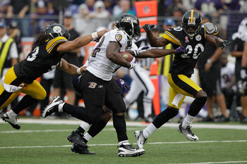 BALTIMORE, MD - SEPTEMBER 11: Running back Ricky Williams #34 of the Baltimore Ravens is tackled by Troy Polamalu #43 and  Bryant McFadden #20 of the Pittsburgh Steelers during second half of the season opener at M&T Bank Stadium on September 11, 2011 in