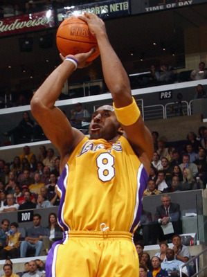 LOS ANGELES - NOVEMBER 22:  Kobe Bryant #8 of the Los Angeles Lakers shoots over Eddie Robinson #32 of the Chicago Bulls during the NBA game at Staples Center on November 22, 2002 in Los Angeles, California.  The Lakers won 86-73.  NOTE TO USER: User expr