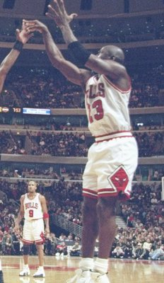 7 Dec 1996: Guard Michael Jordan of the Chicago Bulls shoots the ball over guard Tim Hardaway of the Miami Heat at the United Center in Chicago, Illinois. The Heat won the game 83-80.