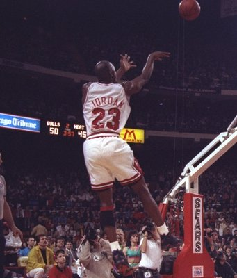 24 Apr 1992: Guard Michael Jordan of the Chicago Bulls takes a shot during a first round playoff game against the Miami Heat at the United Center in Chicago, Illinois.