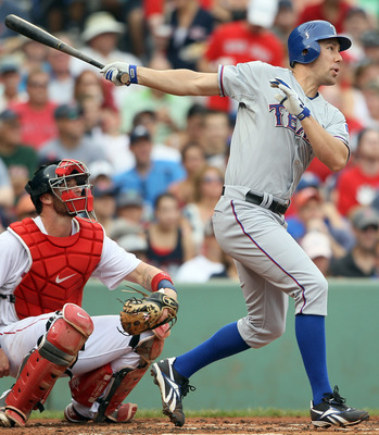 BOSTON, MA - SEPTEMBER 04:  David Murphy #7 of the Texas Rangers hits a triple as Jarrod Saltalamacchia #39 of the Boston Red Sox catches on September 4, 2011 at Fenway Park in Boston, Massachusetts.  (Photo by Elsa/Getty Images)