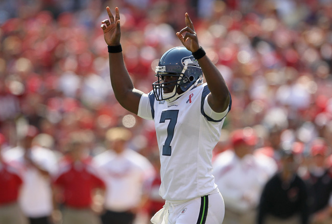 SAN FRANCISCO, CA - SEPTEMBER 11:  Tarvaris Jackson #7 of the Seattle Seahawks celebrates after the Seahawks scored a touchdown against the San Francisco 49ers during their season opener at Candlestick Park on September 11, 2011 in San Francisco, Californ