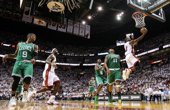 MIAMI, FL - MAY 11:  Dwyane Wade #3 of the Miami Heat shoots over Glen Davis #11 of the Boston Celtics during Game Five of the Eastern Conference Semifinals of the 2011 NBA Playoffs at American Airlines Arena on May 11, 2011 in Miami, Florida. NOTE TO USE