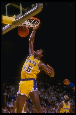1989-90:  Forward A. C. Green of the Los Angeles Lakers slam dunks the ball during a game against the Golden State Warriors at the Great Western Forum in Inglewood, California. Mandatory Credit: Mike Powell  /Allsport Mandatory Credit: Mike Powell  /Allsp