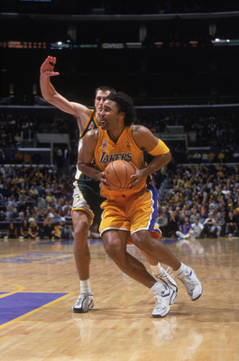 11 Dec 2001:  Forward Rick Fox #17 of the Los Angeles Lakers drives past guard Brent Barry #31 of the Seattle SuperSonics during the NBA game at the Staples Center in Los Angeles, California.  The SuperSonics defeated the Lakers 104-93.Mandatory Credit: J
