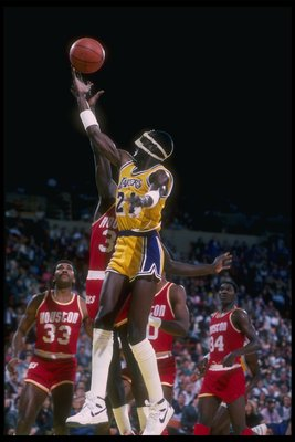 1985-1986:  Michael Cooper of the Los Angeles Lakers goes up for the ball during a game. Mandatory Credit: Stephen Dunn  /Allsport Mandatory Credit: Stephen Dunn  /Allsport