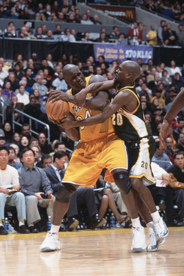 11 Dec 2001:  Center Shaquille O''Neal #34 of the Los Angeles Lakers wrestles the ball away from point guard Gary Payton #20 of the Seattle SuperSonics during the NBA game at the Staples Center in Los Angeles, California.  The SuperSonics defeated the Lak