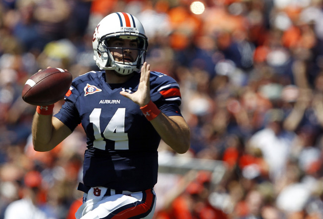 AUBURN, AL - SEPTEMBER 10:  Quarterback Barrett Trotter #14 looks for a receiver against the Mississippi State Bulldogs in the first half on September 10, 2011 at Jordan-Hare Stadium in Auburn, Alabama. (Photo by Butch Dill/Getty Images)
