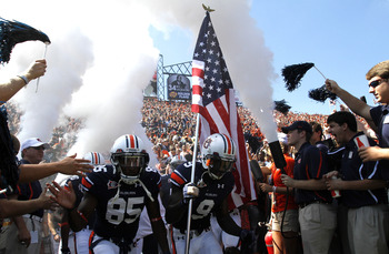 AUBURN, AL - SEPTEMBER 10:  Wide receiver Quindarius Carr #9 of the Auburn Tigers runs onto the field carrying the American Flag with  wide receiver Travante Stallworth #85 of the Auburn Tigers on September 10, 2011 at Jordan-Hare Stadium in Auburn, Alaba