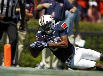 AUBURN, AL - SEPTEMBER 10: Wide receiver Emory Blake #80 of the Auburn Tigers dives for the endzone for a touchdown against Mississippi State in the second quarter on September 10, 2011 at Jordan-Hare Stadium in Auburn, Alabama. (Photo by Butch Dill/Getty