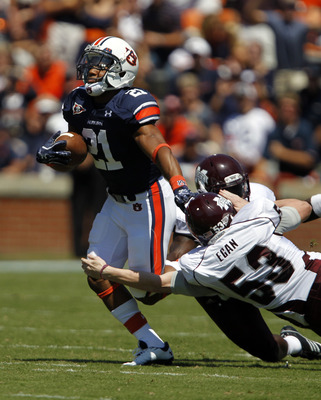 AUBURN, AL - SEPTEMBER 10:  Running back Tre Mason #21 of the Auburn Tigers gets past kicker Brian Egan #53 of the Mississippi State Bulldogs and defensive back Charles Mitchell #4 for a big return in the first quarter on September 10, 2011 at Jordan-Hare