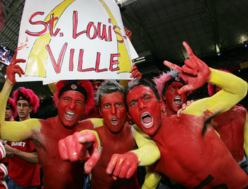 ST. LOUIS - APRIL 2:  Louisville Cardinals fans (L-R) Tony Kamer, Stephen Candido and Michael Sticklen cheer their team on against the Illinois Fighting Illini before the start of the NCAA Men's Final Four at the Edward Jones Dome on April 2, 2005 in St.