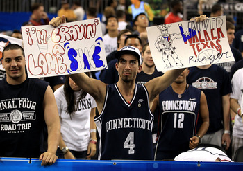 HOUSTON, TX - APRIL 04:  A Connecticut Huskies fan holds up signs before the Huskies take on the Butler Bulldogs in the National Championship Game of the 2011 NCAA Division I Men's Basketball Tournament at Reliant Stadium on April 4, 2011 in Houston, Texa