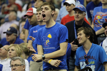 TULSA, OK - MARCH 20:  A Kansas Jayhawks fan cheers during the third round game against the Illinois Fighting Illini in the 2011 NCAA men's basketball tournament at BOK Center on March 20, 2011 in Tulsa, Oklahoma.  (Photo by Ronald Martinez/Getty Images)