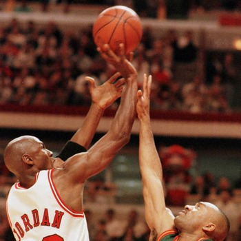 7 Jun 1996:   Michael Jordan #23 of the Chicago Bulls puts up a shot over Hersey Hawkins #33 of the Seattle Supersonics during  third quarter action of game two of the NBA Finals at the United Center in Chicago, Illinois. The Bulls went on to defeat the S