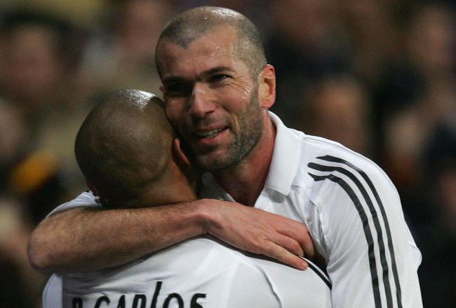 MADRID, SPAIN - FEBRUARY 4: Zinedine Zidane of Real Madrid celebrates his goal with Roberto Carlos during the Primera Liga match between Real Madrid and Espanyol at the Santiago Bernabeu stadium on February 4, 2006 in Madrid, Spain. (Photo by Denis Doyle/
