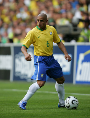 GENEVA - JUNE 04:  Roberto Carlos of Brazil in action during the international friendly match between Brazil and New Zealand at the Stadium de Geneva on June 4, 2006 in Geneva, Switzerland.  (Photo by Stuart Franklin/Getty Images)