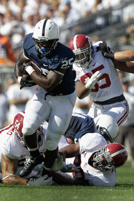 STATE COLLEGE, PA - SEPTEMBER 10: Running back Silas Redd #25 of the Penn State Nittany Lions breaks the tackle of Jesse Williams #54 and Dont'a Hightower #30 (R) of the Alabama Crimson Tide during the second half at Beaver Stadium on September 10, 2011 i