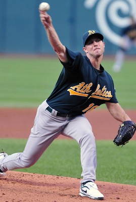 CLEVELAND, OH - AUGUST 31: Starter Rich Harden #18 of the Oakland Athletics pitches during the first inning against the Oakland Athletics at Progressive Field on August 31, 2011 in Cleveland, Ohio. (Photo by Jason Miller/Getty Images)