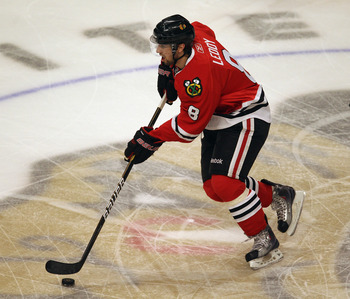 CHICAGO, IL - APRIL 17: Nick Leddy #8 of the Chicago Blackhawks skates up the ice against the Vancouver Canucks in Game Three of the Western Conference Quarterfinals during the 2011 NHL Stanley Cup Playoffs at the United Center on April 17, 2011 in Chicag