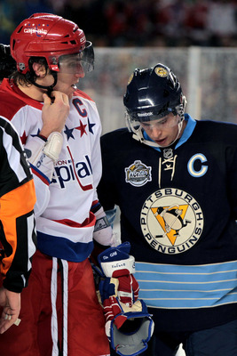 PITTSBURGH, PA - JANUARY 01:  Alex Ovechkin #8 of the Washington Capitals and Sidney Crosby #81 of the Pittsburgh Penguins are seen during the 2011 NHL Bridgestone Winter Classic at Heinz Field on January 1, 2011 in Pittsburgh, Pennsylvania. Washington wo