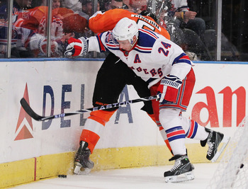 NEW YORK - MARCH 6:  Ryan Callahan #24 of the New York Rangers checks Braydon Coburn #5 of the Philadelphia Flyers during their game on March 6, 2011 at Madison Square Garden in New York City, New York.  (Photo by Al Bello/Getty Images)