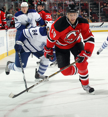 NEWARK, NJ - APRIL 06: Travis Zajac #19 of the New Jersey Devils skates against the Toronto Maple Leafs at the Prudential Center on April 6, 2011 in Newark, New Jersey.  (Photo by Bruce Bennett/Getty Images)