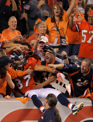 DENVER, CO - SEPTEMBER 12:  Punt returner Eric Decker #87 of the Denver Broncos jumps into the stands after returning a punt 90-yards for a touchdown in the third quarter against the Oakland Raiders at Sports Authority Field at Mile High on September 12,