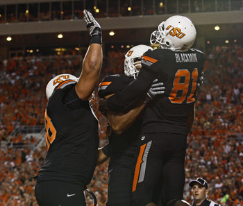 STILLWATER, OK - SEPTEMBER 8:  Wide receiver Justin Blackmon  #81, outside linebackers Jonathon Rush #70 and Lane Taylor #68  of the Oklahoma State Cowboys celebrate a touchdown in the first half against the Arizona Wildcats on September 8, 2011 at Boone