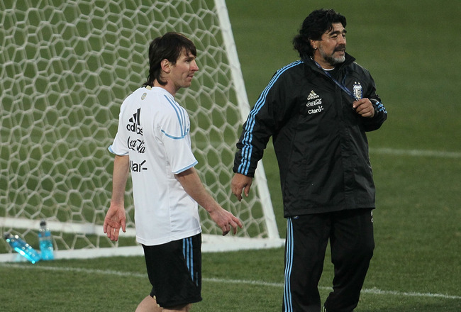 PRETORIA, SOUTH AFRICA - JUNE 30:  Argentina's head coach Diego Maradona and Lionel Messi wait for a corner kick during a team training session on June 30, 2010 in Pretoria, South Africa.  (Photo by Chris McGrath/Getty Images)