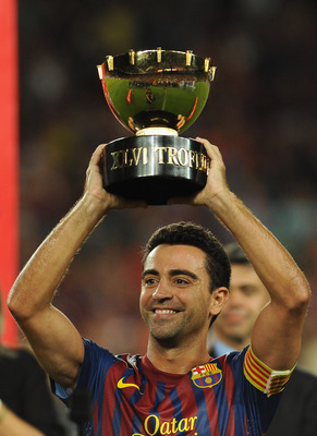 BARCELONA, SPAIN - AUGUST 22:  Xavi of FC Barcelona with the trophy at the end of the Joan Gamper Trophy match between FC Barcelona and SSC Napoli on August 22, 2011 in Barcelona, Spain.  (Photo by Valerio Pennicino/Getty Images)