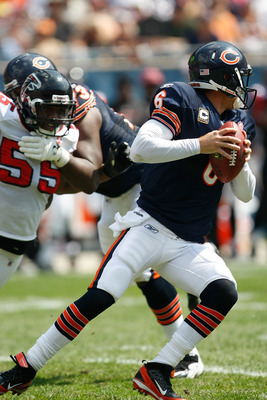 CHICAGO, IL - SEPTEMBER 11: Jay Cutler #6 of the Chicago Bears runs as he tries to avoid John Abraham #55 of the Atlanta Falcons at Soldier Field on September 11, 2011 in Chicago, Illinois. (Photo by Scott Boehm/Getty Images)