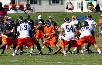BOURBONNAIS, IL - JULY 30: Jay Cutler #6 of the Chicago Bears drops back to pass during a summer training camp practice at Olivet Nazarene University on July 30, 2011 in Bourbonnais, Illinois.  (Photo by Jonathan Daniel/Getty Images)