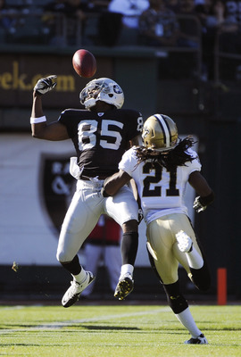 OAKLAND, CA - AUGUST 28:  Darrius Heywar-Bey #85 of the Oakland Raiders fails to pick up a pass over Patrick Robinson #21 of the New Orleans Saints in the first quarter during an NFL pre-season football game at the O.co Coliseum August 28, 2011 in Oakland