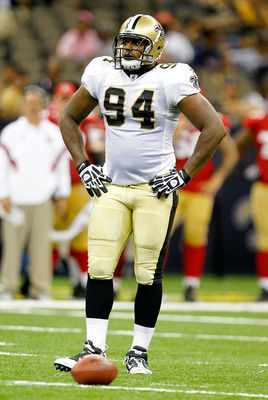 NEW ORLEANS, LA - AUGUST 12: Cameron Jordan # 94 of the New Orleans Saints looks on as his team plays the San Francisco 49ers during their pre season game at Louisiana Superdome on August 12, 2011 in New Orleans, Louisiana.  (Photo by Sean Gardner/Getty I