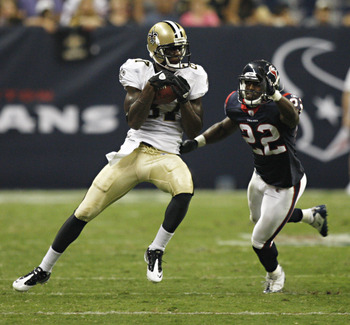 HOUSTON - AUGUST 20:  Wide receiver Adrian Arrington #87 of the New Orleans Saints completes a reception in front of cornerback Sherrick McManis #22 of the Houston Texans at Reliant Stadium on August 20, 2011 in Houston, Texas.  (Photo by Bob Levey/Getty