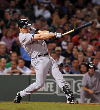 BOSTON, MA - SEPTEMBER 1: Mark Teixeira #25 of the New York Yankees swings at a pitch in the fifth inning against the Boston Red Sox at Fenway Park on September 1, 2011 in Boston, Massachusetts. The Yankees won the game 4-2. (Photo by Darren McCollester/G