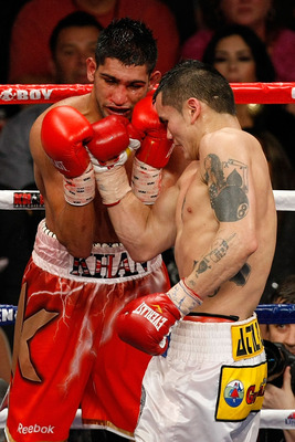 LAS VEGAS - DECEMBER 11:  (R-L) Marcos Maidana of Argentina connects with a right at Amir Khan of England during the WBA super lightweight title fight at Mandalay Bay Events Center on December 11, 2010 in Las Vegas, Nevada.  (Photo by Ethan Miller/Getty I