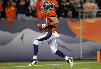 DENVER, CO - SEPTEMBER 12:  Punt returner Eric Decker #87 of the Denver Broncos crosses the goaline after returning a punt 90-yards for a touchdown in the third quarter against the Oakland Raiders at Sports Authority Field at Mile High on September 12, 20