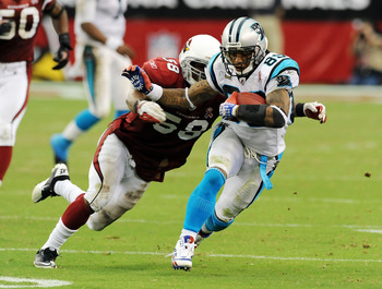 GLENDALE, AZ - SEPTEMBER 11:  Steve Smith #89 of the Carolina Panthers runs away from Daryl Washington #58 of the Arizona Cardinals in the NFL season opening game at the University of Phoenix Stadium on September 11, 2011 in Glendale, Arizona. Arizona won