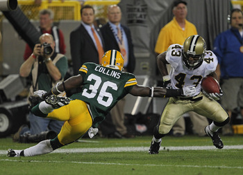 GREEN BAY, WI - SEPTEMBER 08:  Darren Sproles #43 of the New Orleans Saints tries to move around Nick Collins #36 of the Green Bay Packers during the NFL opening season game at Lambeau Field on September 8, 2011 in Green Bay, Wisconsin. The Packers defeat