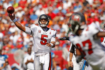 TAMPA, FL - SEPTEMBER 11:  Josh Freeman #5 of the Tampa Bay Buccaneers makes a pass during the season opener against the Detroit Lions at Raymond James Stadium on September 11, 2011 in Tampa, Florida.  (Photo by Mike Ehrmann/Getty Images)