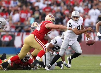 SAN FRANCISCO, CA - AUGUST 20:  Jason Campbell #8 of the Oakland Raiders fumbles the ball while being chased by Justin Smith #94 of the San Francisco 49ers at Candlestick Park on August 20, 2011 in San Francisco, California.  (Photo by Ezra Shaw/Getty Ima