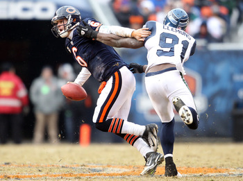 CHICAGO, IL - JANUARY 16:  Quarterback Jay Cutler #6 of the Chicago Bears attempts to avoid a sack by Chris Clemons #91 of the Seattle Seahawks in the second half of the 2011 NFC divisional playoff game at Soldier Field on January 16, 2011 in Chicago, Ill