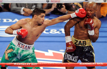 LAS VEGAS, NV - JULY 23:  (L-R) Amir Khan throws a left to the face of Zab Judah during their super lightweight world championship unification bout at Mandalay Bay Events Center on July 23, 2011 in Las Vegas, Nevada.  (Photo by Ethan Miller/Getty Images)
