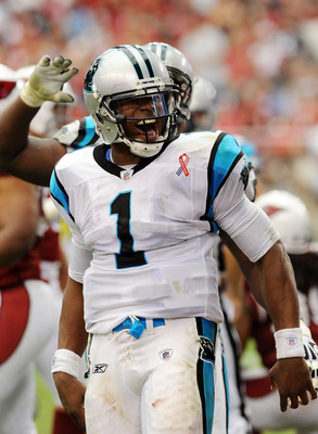 GLENDALE, AZ - SEPTEMBER 11:  Quarterback Cam Newton #1 of the Carolina Panthers celebrates his first rushing touchdown against the Arizona Cardinals in the NFL season opening game at the University of Phoenix Stadium on September 11, 2011 in Glendale, Ar