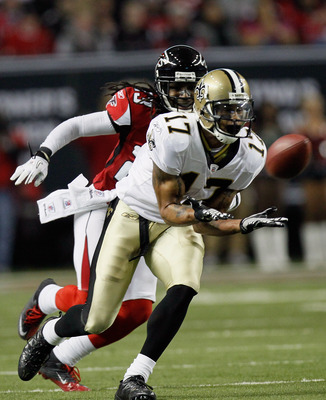 ATLANTA, GA - DECEMBER 27:  Robert Meachem #17 of the New Orleans Saints reaches for a pass as Atlanta Falcons defender Dunta Robinson #23 looks on in the first half during their game at the Georgia Dome on December 27, 2010 in Atlanta, Georgia.  (Photo b